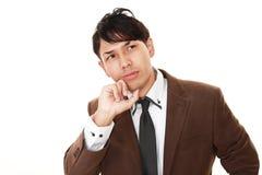 Портрет бизнесмена смотря неловкий Стоковое фото RF