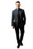 Портрет бизнесмена стоя с компьтер-книжкой Стоковая Фотография