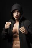 Портрет бойца сильного человека изолированный на черноте Стоковое Фото