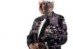 Портрет бородатого бизнесмена Город двойной экспозиции на предпосылке Стоковая Фотография
