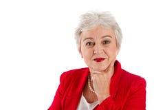 Портрет более старой женщины изолированной на белизне стоковые фото