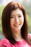 Портрет головных и плеч китайской женщины Стоковые Изображения