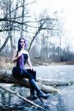 Портрет готической женщины на замороженном озере Стоковые Изображения RF