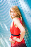 портрет девушки предпосылки голубой Стоковая Фотография