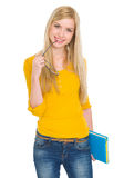 Портрет девушки студента с книгой и стеклами стоковая фотография rf