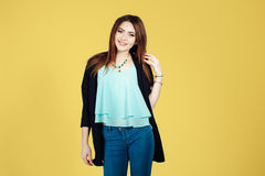 Портрет девушки на желтой предпосылке Стоковое фото RF