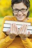 Портрет девушки с книгами Стоковые Фотографии RF