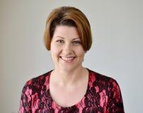 Портрет женщины в красном платье Стоковая Фотография