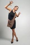 Портрет женщины моды в современном платье Стоковая Фотография