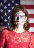Портрет женщины с покрашенным флагом США Стоковая Фотография