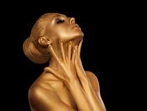 Портрет золота девушки стоковое изображение