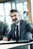 Портрет зрелого бизнесмена в встрече Стоковое Изображение RF