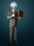 портрет компьтер-книжки головной лампы бизнесмена Стоковые Изображения RF