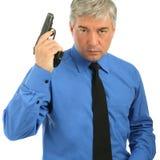 Портрет Конца-вверх взрослого человека с пушкой Стоковое Изображение