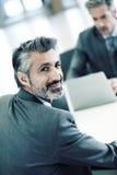 Портрет красивого бизнесмена в встрече Стоковое Фото