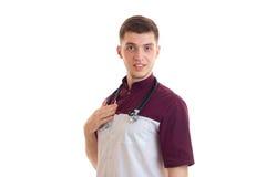 Портрет красивого молодого доктора в форме Стоковое Изображение