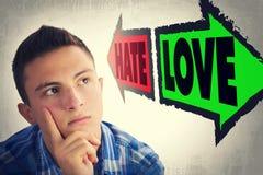 Портрет красивого подростка смотреть на с выбором между НЕНАВИСТЬЮ и Стоковые Фотографии RF