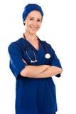 Портрет красивого успешного доктора в голубой форме стоковое изображение rf