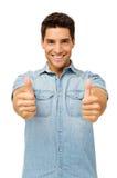 Портрет красивого человека показывать большие пальцы руки вверх стоковое изображение