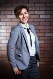 Портрет красивой девушки в костюме Стоковые Фото