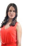 Портрет красивой девушки в красном цвете Стоковые Изображения