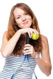 Портрет красивой девушки с ракеткой тенниса на белизне Стоковое Фото