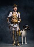 Портрет красивой девушки steampunk с идя ручкой и делает Стоковое Изображение