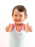 Портрет красивой и уверенно девушки показывая вверх изолированные большие пальцы руки Стоковые Изображения RF