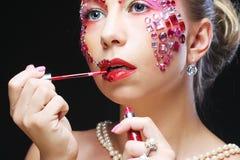Портрет крупного плана женщины с художническим составом Стоковое фото RF