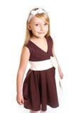 Портрет маленькой девочки в платье на белой предпосылке Стоковые Изображения RF