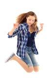 Портрет маленькой девочки скача изолированный над белой предпосылкой Стоковая Фотография RF