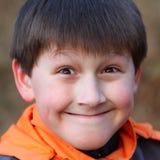 портрет мальчика близкий радостный вверх Стоковые Изображения RF