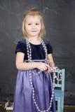 Портрет маленькой милой девушки около классн классного Стоковые Фотографии RF