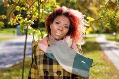 Портрет милой маленькой девочки с красными волосами стоковое фото
