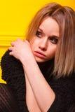 Портрет милой девушки на желтой предпосылке Стоковая Фотография