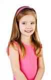 Портрет милой усмехаясь изолированной маленькой девочки Стоковое фото RF