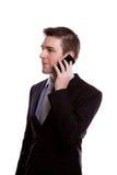 Портрет молодого бизнесмена на телефоне. Стоковые Фото