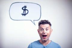 Портрет молодого человека с знаком доллара пузыря речи стоковая фотография