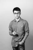Портрет молодого бизнесмена говоря на телефоне Стоковое Изображение RF