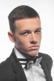 Портрет молодого бизнесмена изолированного на белой предпосылке Стоковые Изображения