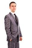 Портрет молодого бизнесмена стоя с одной рукой в его p Стоковое Фото