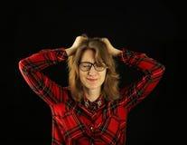 Портрет молодого красивого конца-вверх девушки в красной checkered рубашке с различными эмоциями на ее стороне Стоковое фото RF