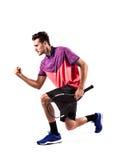 Портрет молодого мужского теннисиста празднуя его успех Стоковое Изображение