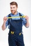 Портрет молодого работника в форме с желтой измеряя лентой Стоковое фото RF