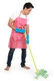 Портрет молодого человека с оборудованием чистки Стоковые Фото