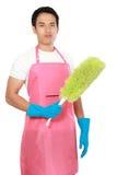 Портрет молодого человека с оборудованием чистки стоковое фото