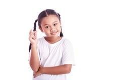 Портрет молодой азиатской девушки изолированной на белизне Стоковое Фото