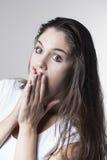 Портрет молодой женщины брюнет делая стороны с различным e Стоковая Фотография