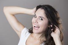 Портрет молодой женщины брюнет делая стороны с различным e Стоковая Фотография RF