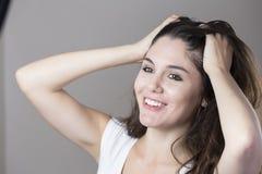 Портрет молодой женщины брюнет делая стороны с различным e Стоковые Фотографии RF
